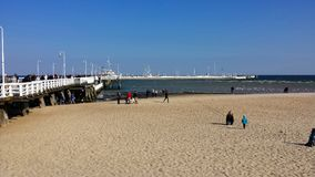 Pier in Sopot, Poland. Sopot, Poland - September 30, 2017: People walk around Sopot Pier Molo. Longest pier in Europe Stock Image