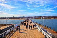Pier in Sopot, Poland. Tourists walking on the Sopot Pier on March 09, 2014 in Sopot, Poland stock photography