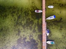 Pier with speed boats, marina lot. Aerial view from drone Stock Image