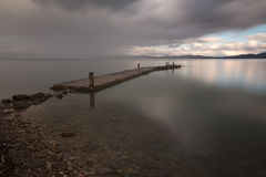 Pier and still water Royalty Free Stock Photos