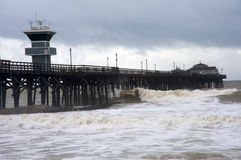 Pier during storm. Seal Beach Pier, California, during rain storm. Big waves hit the structure Stock Images