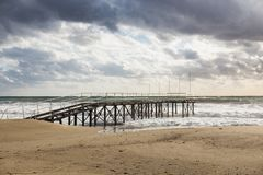 Pier in the storming sea Stock Photography