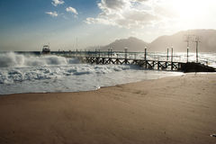 Pier in stormy seas, Nuweiba Egypt. A pier in stormy seas in Nuweiba on the Sinai peninsula in Egypt royalty free stock photography