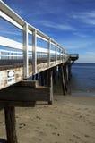 Pier am Strand Stockfoto