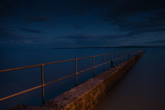 The pier by street light Royalty Free Stock Photo
