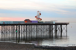 Pier structure at low tide reflections Royalty Free Stock Image