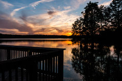 Pier at Stumpy Lake in Virginia Beach, Virginia at Dusk. Fishing pier at Stumpy Lake in Virginia Beach, Virginia at dusk Stock Image