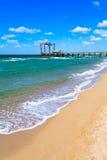 Pier on a summer day on the beach, sandy beach. Russia, Crimea. Royalty Free Stock Photos