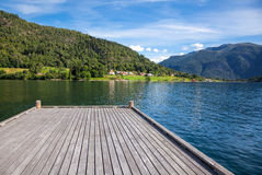 Pier at a summer fjord in Norway Stock Image