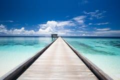 Pier, sun deck and turquoise ocean. Jetty, sun deck and turquoise ocean. View from the beach Stock Images