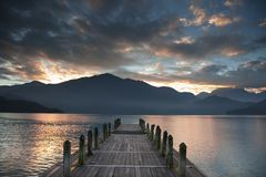 The pier and sunrise Stock Images
