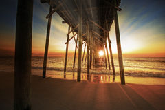 Pier Sunrise. Sunrise at the pier along the coast Stock Photos