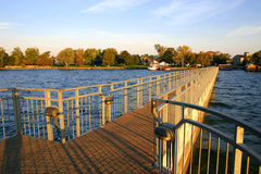 Pier at sunrise. Scenic shot on Lake Skaneateles, New York, though could represent any place Stock Photography