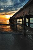 Pier in the sunrise. This is underside of an old pier in the sunrise , Hua Hin ,Thailand Stock Photos