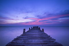 Pier in sunrise Stock Photos
