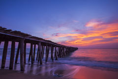 Pier in sunrise Stock Images
