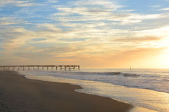 The pier at sunrise on Atlantic ocean. Royalty Free Stock Image
