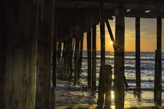 Pier at Sunrise. Catching the sun starburst at the ocean pier in the outer banks, North Carolina Royalty Free Stock Image