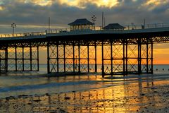 Pier or jetty, colourful sunrise. Cromer. UK. Royalty Free Stock Photography