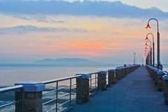 Pier at Sunrise. In Malaysia. The Pier juts out to the Malacca Strait Stock Images