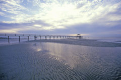 Pier at sunrise over the Gulf of Mexico, Biloxi, MS Stock Photo