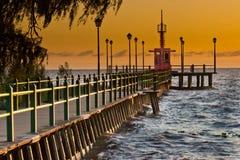 Pier sunrise. Pier river sunrise coast shore Stock Photo
