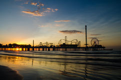 Pier at sunrise. A sunrise shot of the pier in Galveston, Texas royalty free stock image