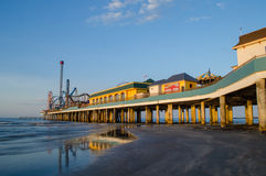 Pier at sunrise. A sunrise shot of the pier in Galveston, Texas royalty free stock photo