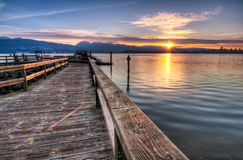 Pier With Sunrise Sunstar Stock Photos