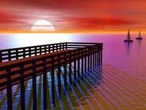 Pier at Sunset. With yachts with oranges and pinks Royalty Free Stock Photos
