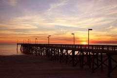 Pier Sunset 2. Pier and sunset on beach royalty free stock image