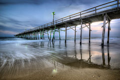 Pier at Sunset. A pier on the beach in North Carolina Royalty Free Stock Photography