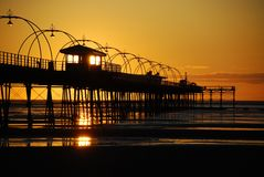 Pier at Sunset. Shelter lit by the sun at Southport Pier at Sunset Royalty Free Stock Photo