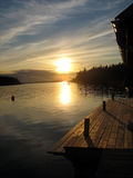 Pier in sunset. In the archipelago in Northern Europe Royalty Free Stock Photos