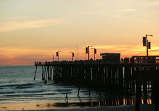 Pier Sunset. Pier Filled with People at Sunset royalty free stock images