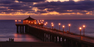 Pier at sunset. Manhattan Beach pier at dusk in southern California stock image