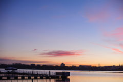 Pier at sunset. Beautiful romantic sunset over a calm lake Royalty Free Stock Images