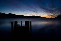 Pier Sunset Derwent Water. Sunset at Derwent Water, Lake District, UK.  Taken from the pier Royalty Free Stock Photo