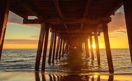 Pier at sunset Stock Photos