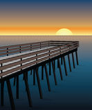 Pier Sunset. Illustration of a pier on the ocean with sunset or sunrise in the background Stock Photos