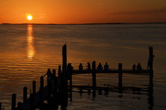 Pier and sunset in Key Largo Florida. People watching the sunset in Florida keys stock photo