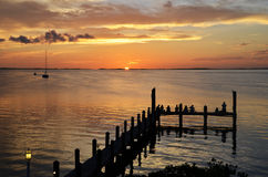 Pier and sunset in Key Largo Florida. People watching the sunset in Florida keys stock photography