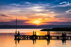 Pier at sunset. Neusiedl lake Royalty Free Stock Photo