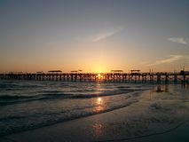 Pier sunset stock images