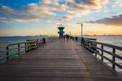 The pier at sunset, in Seal Beach  Royalty Free Stock Images