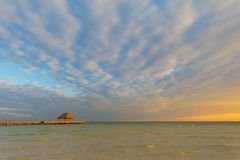 Pier at sunset. Walkway to sunset on Holbox Island, Mexico, romantic setting for Caribbean vavation Royalty Free Stock Images