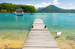 Pier and swan on Lake Annecy in Alps, France Stock Photography