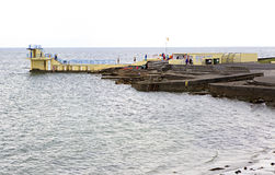 Pier for swimming in the cold Atlantic Ocean Stock Image
