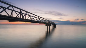 Pier on tagus river. Old industrial pier on tagus river at sunrise in Alhandra, Portugal Stock Photo
