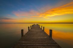 Pier to heaven, Weiden am See, Austria. Pier to heaven in the sunset in Weiden am See, Austria royalty free stock images
